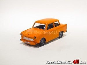 "Scale model of Trabant 601S ""Der Trabi"" Orange (1989) produced by Vitesse."